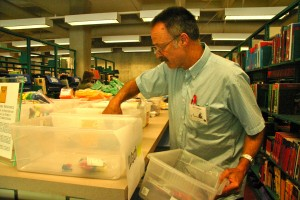 Photo of teacher stocking up on math supplies at Kennedy Library