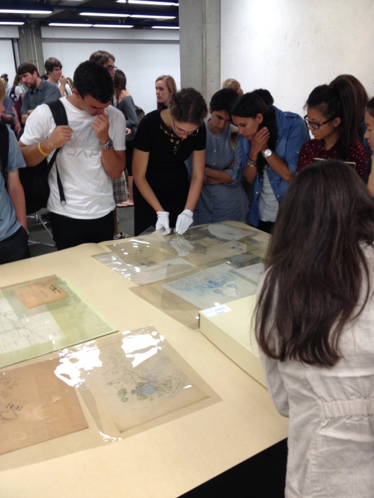 Photo of Cal Poly architecure students review Julia Morgan papers