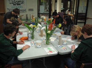 Photo of students painting flowers