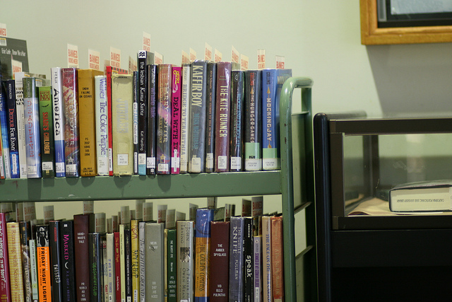 Photo of books on a cart by Kennedy Library on Flickr