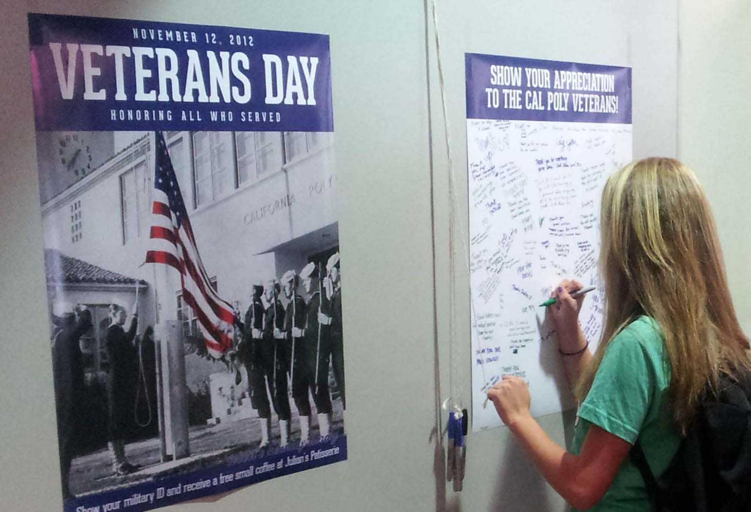 Photo of students signing thanks for Veteran's Day