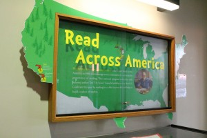 A green cut-out map of the United States, with a photo of Dr. Seuss and the words Read Across America across the top.
