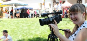 Photo of Vicki using a video camera at Mission Plaza