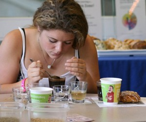 Photo of a student smelling coffee.