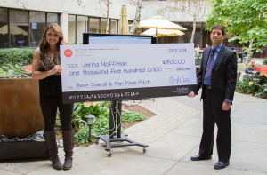 Jenna and Doug pose for a photo with Jenna's big check.