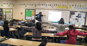 Pete teaching the Binary Dance in a 5th grade math class.