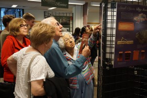 People interact with the exhibit