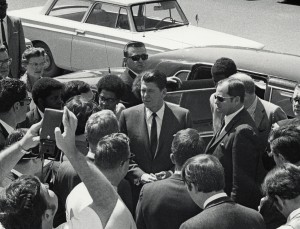 Governor Reagan, surrounded by security, is greeted by students as he arrives at Cal Poly, 1974 (University Archives Photo Collection, University Archives, California Polytechnic State University, ua-pho_00000970).