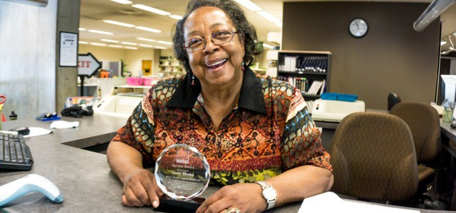 Photo of Judy with award