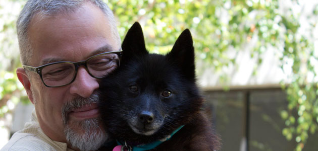 Photo of Mark and a dog