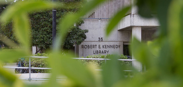 Photo of Kennedy Library through a tree