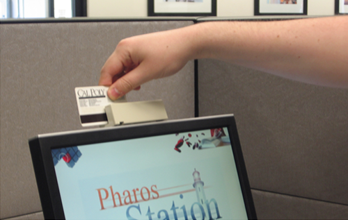 photo of person swiping their card through the cardswipe located on the printer's monitor