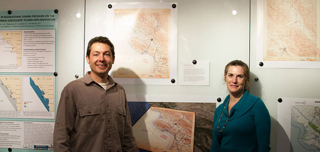 Photo of Russ and Jeanine at map reception in community gallery