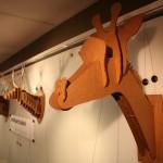 A cardboard, laser-cut giraffe