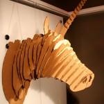 A cardboard laser-cut unicorn.