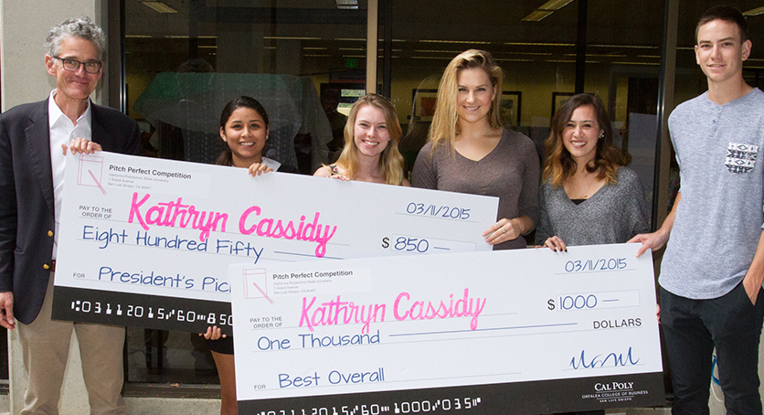 Photo of students with giant checks