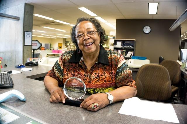 Photo of Judy with award