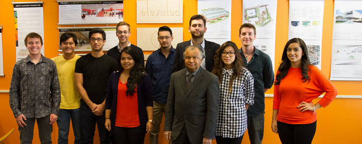 Student designers with Professor Omar Faruque at the Elevated Foundations exhibit.
