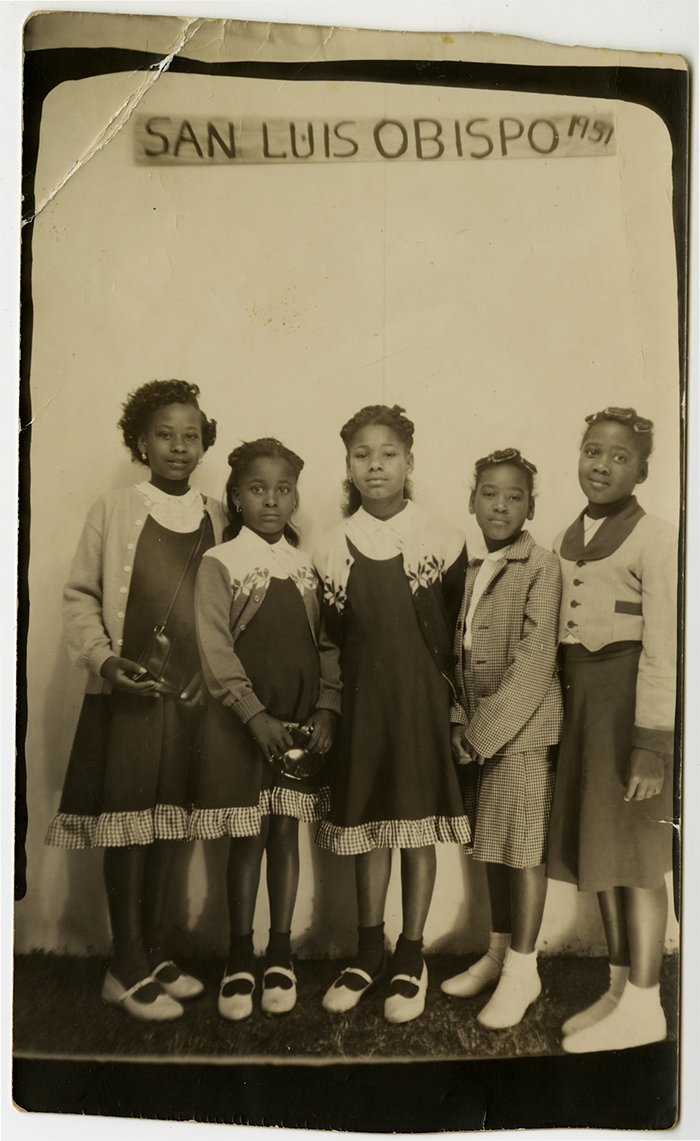 Five young girls photographed in front of a San Luis Obispo sign, 1951. The three on the left are possibly the Williams sisters Alice, Rosa Lee, and Annazette. (Sister's Inn Collection, Special Collections and Archives, California Polytechnic State University, 189_spc_000003)