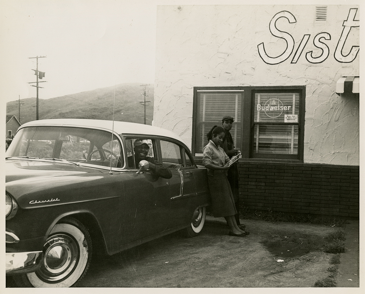Another view of the rebuilt Sister's Inn (we can date this around 1955 by the 1955 Chevy four door sedan pictured).(Sister's Inn Collection, Special Collections and Archives, California Polytechnic State University, 189_spc_000009)