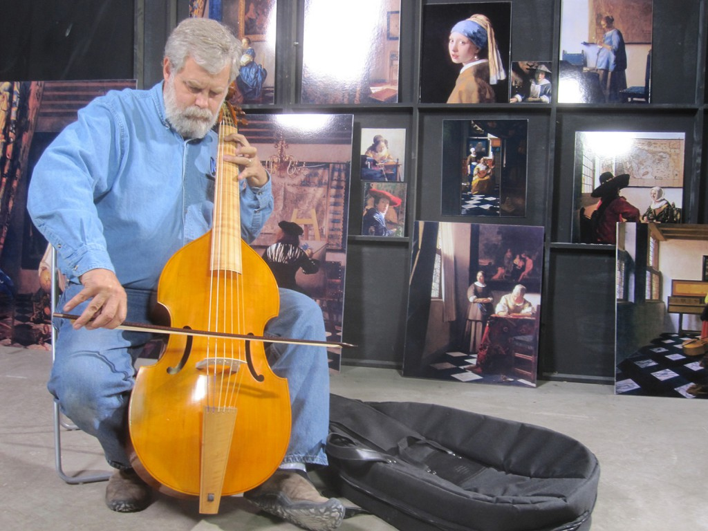 In his warehouse in San Antonio, Texas, Tim Jenison plays the viola de gamba he used to furnish his Vermeer room. Photo by Natalie Jenison, © Tim Jenison, Courtesy of Sony Pictures Classics