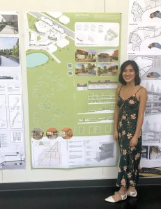 Ali Chen standing in front of her research poster